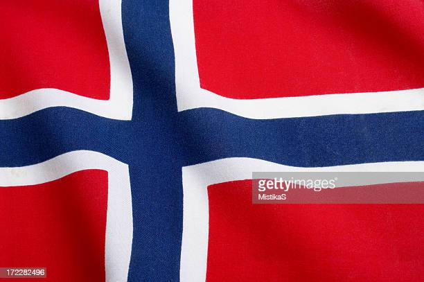 the norwegian flag waving in the wind - norwegian flag stock pictures, royalty-free photos & images