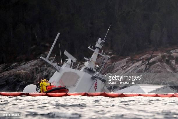 TOPSHOT The Norwegian frigate KNM Helge Ingstad is seen partly under water in the sea near Bergen western Norway on November 13 2018 The frigate...