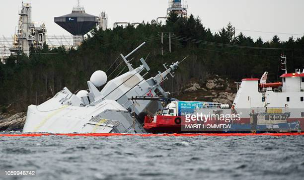 The Norwegian frigate KNM Helge Ingstad takes on water after a collision with the tanker Sola TS on November 10 2018 in the Hjeltefjord near Bergen...