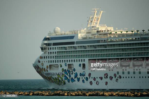 The Norwegian Gem cruise ship leaves the Port of Miami on April 14 2020 in Miami Beach Florida According to reports approximately 80000 workers from...