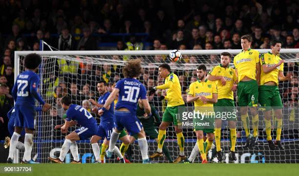 the Norwich City players jump to stop a freekick during The Emirates FA Cup Third Round Replay between Chelsea and Norwich City at Stamford Bridge on...