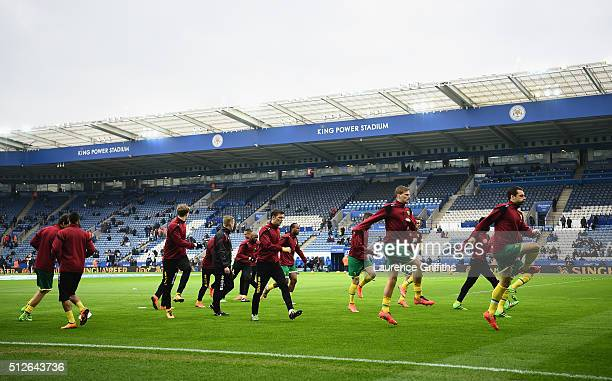 The Norwich City team warm up prior to the Barclays Premier League match between Leicester City and Norwich City at The King Power Stadium on...