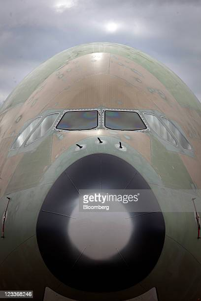 The nose and cockpit of an unpainted Airbus A380 aircraft stands outside the Airbus SAS factory during manufacture in Hamburg Germany on Thursday...