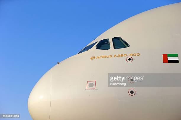 The nose and cockpit windows of an Airbus A380800 aircraft operated by Etihad Airways sits on display on the second day of the 14th Dubai Air Show at...