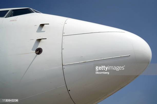 The nose cone of a grounded Lion Air Boeing Co 737 Max 8 aircraft is seen at terminal 1 of SoekarnoHatta International Airport in Cenkareng Indonesia...