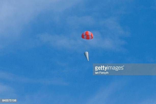 The nose cone section of the Skybolt 2 Research Rocket returns to earth under parachute after its launch from Otterburn in Northumberland on...