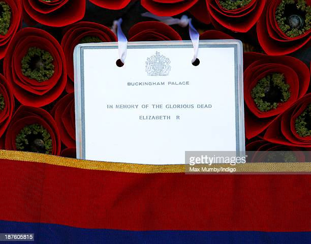 The note on Queen Elizabeth II's poppy wreath which she laid at the Cenotaph during the annual Remembrance Sunday Service on November 10 2013 in...
