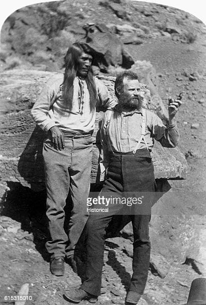 The noted geologist and explorer John Wesley Powell stands with a man of Native American ethnicity somewhere in the southwestern United States ca...