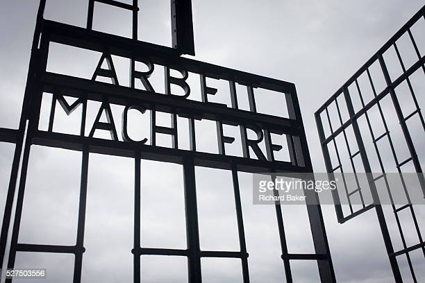 The notorious moto in German labour and extermination camps Arbeit Macht Frei in the Nazi and Soviet Sachsenhausen concentration camp during WW2 now...