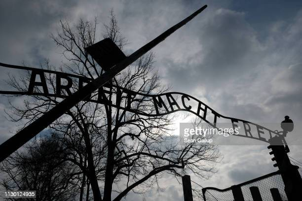 "The notorious ""Work Makes One Free"" inscription stands at the entrance to the Auschwitz I memorial concentration camp site on February 15, 2019 in..."
