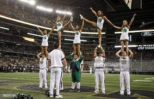 The Notre Dame cheerleaders perform during a college football game against Arizona State at ATT Stadium in Arlington Texas Saturday October 5 2013...