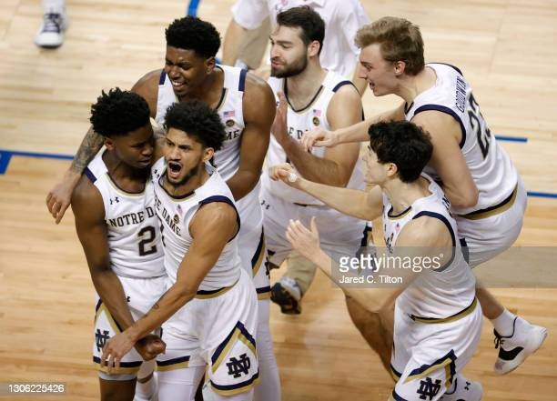 The Notre Dame Fighting Irish celebrate following a three point basket at the buzzer by Trey Wertz to secure the 80-77 win over the Wake Forest Demon...