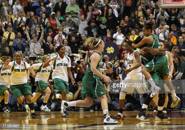 The Notre Dame Fighting Irish celebrate the win over the Connecticut Huskies during the semifinals of the 2011 NCAA Women's Final Four on April 3,...