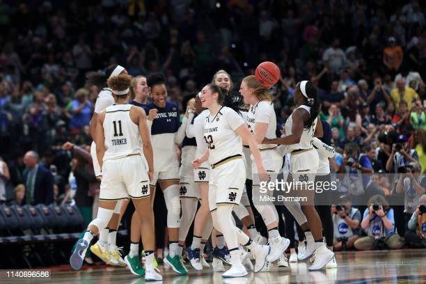 The Notre Dame Fighting Irish celebrate their 8176 win over the UConn Huskies in the semifinals of the 2019 NCAA Women's Final Four at Amalie Arena...