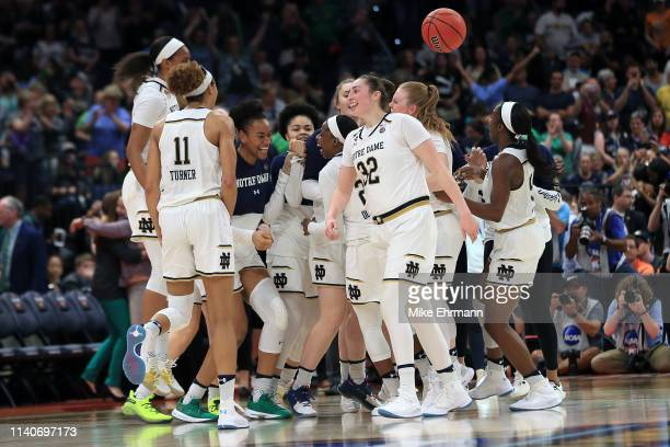 The Notre Dame Fighting Irish celebrate their 81-76 win over the UConn Huskies in the semifinals of the 2019 NCAA Women's Final Four at Amalie Arena...