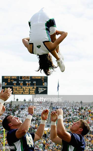 The Notre Dame Fighting Irish cheerleaders perform during the game with the Michigan State Spartans on September 17 2005 at Notre Dame Stadium in...
