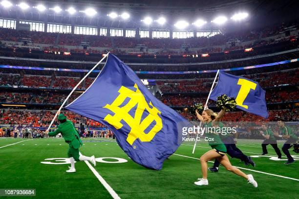 The Notre Dame Fighting Irish cheerleaders take the field before the game against the Clemson Tigers during the College Football Playoff Semifinal...