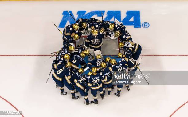 The Notre Dame Fighting Irish huddle around Cale Morris before the NCAA Division I Men's Ice Hockey Northeast Regional Championship final against the...