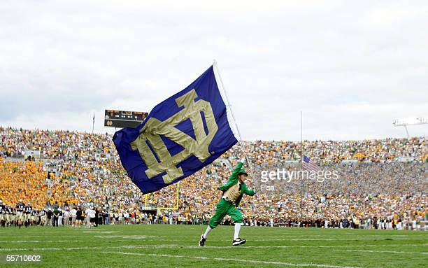 The Notre Dame Fighting Irish mascot carries the school flag on the field before the game against the Michigan State Spartans on September 17 2005 at...