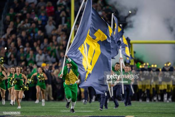 The Notre Dame Fighting Irish mascot runs onto the field before the college football game between the Notre Dame Fighting Irish and Stanford...