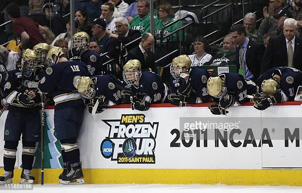The Notre Dame Fighting Irish react to their loss to the Minnesota Duluth Bulldogs during semifinals of the 2011 NCAA Men's Frozen Four on April 7,...