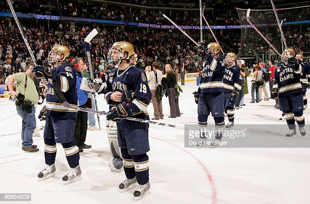 The Notre Dame Fighting Irish salute as they leave the ice after being defeated by the Boston College Golden Eagles in the 2008 NCAA Frozen Four...