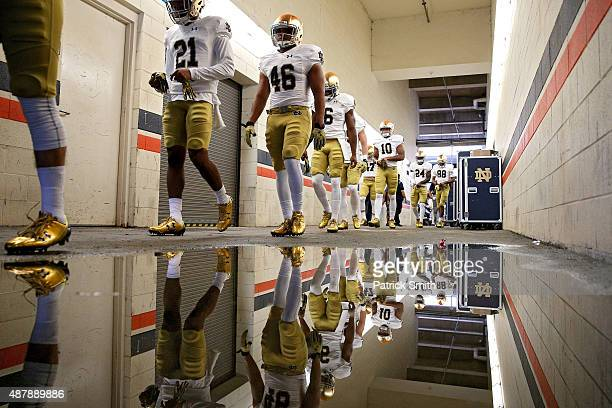 The Notre Dame Fighting Irish walk to the field for warmups before playing the Virginia Cavaliers at Scott Stadium on September 12, 2015 in...