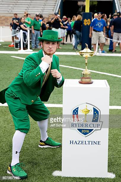 The Notre Dame Leprechaun poses with the Ryder Cup Trophy as it visits Michigan State v Notre Dame Football at Notre Dame Stadium on September 17...