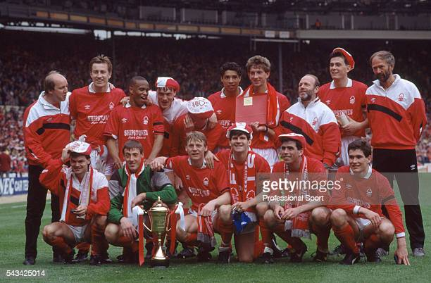 The Nottingham Forest team celebrate with the trophy after their victory in the Simod Cup Final between Everton and Nottingham Forest held at Wembley...