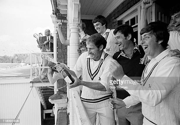 The Nottinghamshire team celebrate after winning the County Cricket Championship following a 10 wicket victory over Glamorgan at Trent Bridge in...