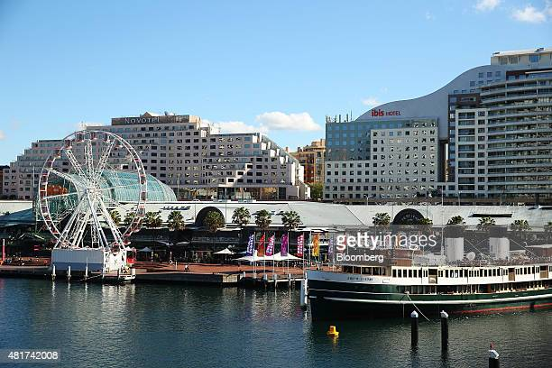 The Novotel Sydney Hotel, left, and the Ibis Hotel stand at Darling Harbor in Sydney, Australia, on Tuesday, July 21, 2015. Tired hotels, outdated...