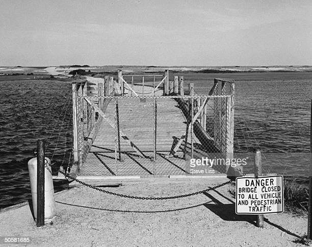 The now fencedoff Dike Bridge w Danger Bridge Closed sign in front of it Mary Jo Kopechne drowned in the car that Sen Ted Kennedy drove off this...