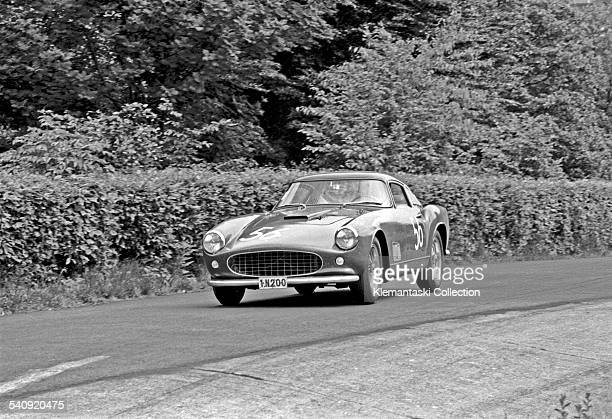 The Nürburgring 1000 km Race Nürburgring June 7 1959 The Ferrari 250GT entered by Ecurie Francorchamps of Brussles and driven by Leon Dernier and...