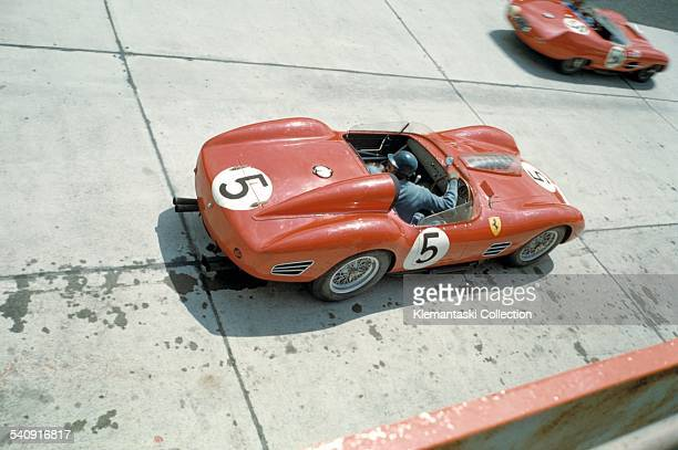 The Nürburgring 1000km Race Nürburgring June 7 1959 Tony Brooks pulls out of the pits during practice with the Ferrari 250TR/59 which he will share...