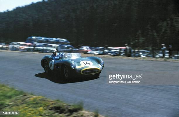 The Nürburgring 1000km Race Nürburgring May 26 1957 Noel CunninghamReid at speed in the winning Aston Martin He actually helped Brooks increase their...