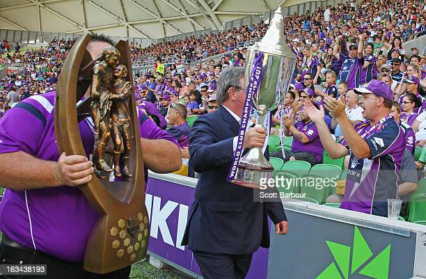The NRL Premiership trophy and the World Club Challenge trophy both won by Melbourne Storm are displayed to the crowd prior to the round one NRL...