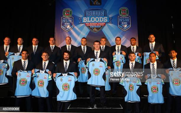 The NSW Blues team are presented with their jerseys for game II during the New South Wales Blues State of Origin team announcement at ANZ Stadium on...