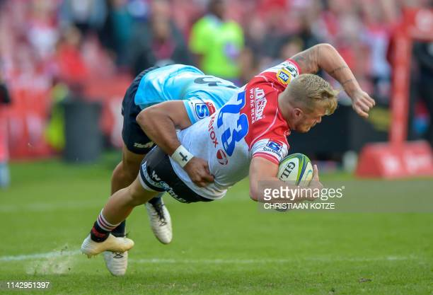 The NSW Waratah's Curtis Rona tackles The Emirates Lions' Tyrone Green during the Super Rugby match Emirates Lions v NSW Waratahs at the Emirates...