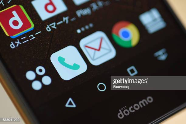 The NTT Docomo Inc logo is seen on a Fujitsu Ltd Arrows NX smartphone at one of the company's stores in Tokyo Japan on Monday April 24 2017 NTT...