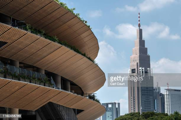 The NTT DoCoMo Yoyogi Building looms behind the underconstruction New National Stadium the main stadium for the upcoming Tokyo 2020 Olympic and...