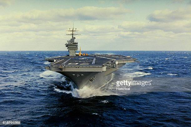 The nuclearpowered aircraft carrier Carl Vinson underway off the Virginia coast during sea trials prior to commissioning January 26 1982