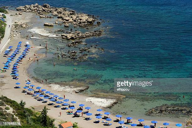 the nudist beach of rhodes - naturalist beach stock photos and pictures