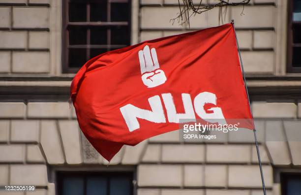 The NUG flag seen in Parliament Square during the demonstration. Demonstrators gathered to protest against the military coup in Myanmar and to demand...