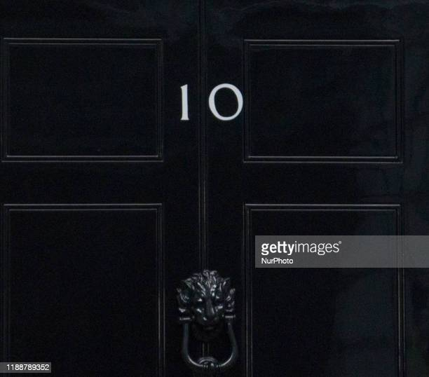 The number 10 door is seen in Downing Street after Boris Johnson secured majority with 365 seats in the Parliament , in London , on 13 December 2019.