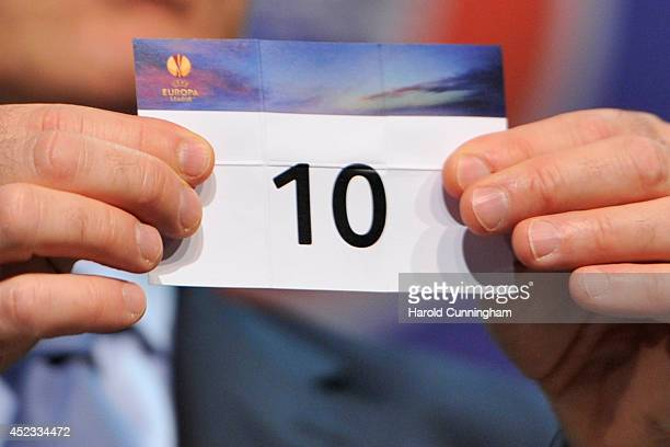 The number 10 is drawn during the UEFA 2014/15 Europa League third qualifying rounds draw at the UEFA headquarters The House of European Football on...