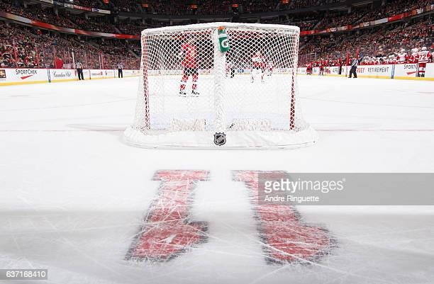 The number 11 is embedded in the ice in honor of Daniel Alfredsson's jersey retirement ceremony during an NHL game between the Ottawa Senators and...