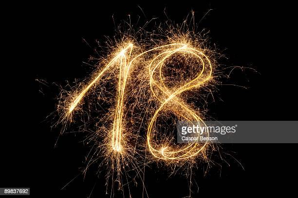The number 18 written with a sparkler