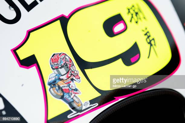 The number 19 on the bike of Alvaro Bautista of Spain and PullBear Aspar Team with inside remember Nicky Hayden of Spain during the MotoGp of...