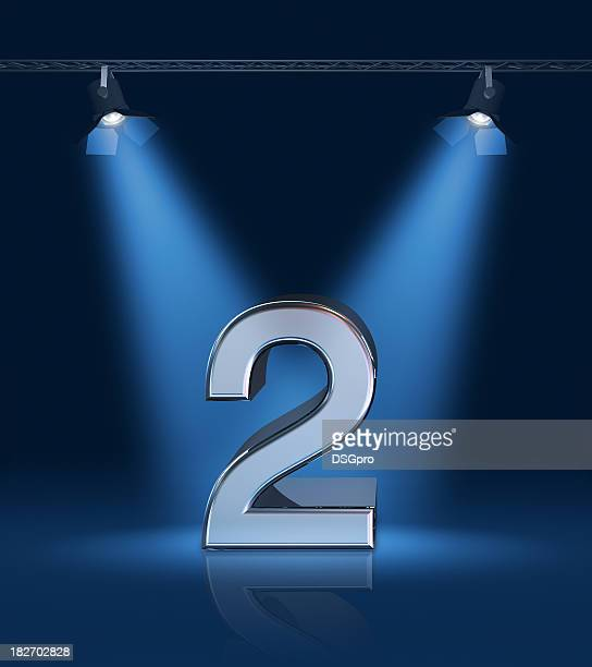 the number 2 depicted on a stage with bright blue lights - second place stock pictures, royalty-free photos & images