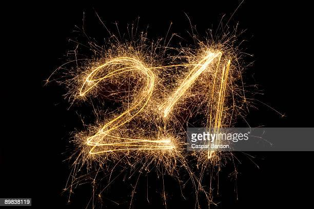 The number 21 written with a sparkler